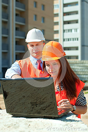 Architects  works in front of building site