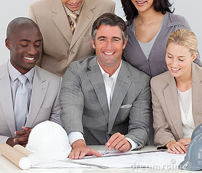 Architectural business team studying plans