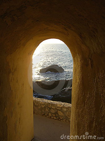 Archway view over rocky shore