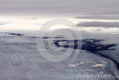 Arctic glacier and the stone river in it