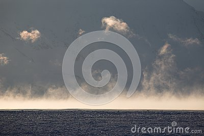 Arctic landscape - fog over the sea