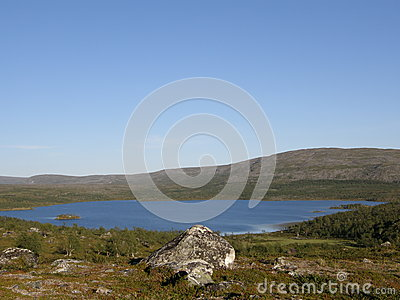 Arctic landscape with a mountain lake