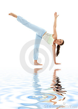 Ardha chandrasana half moon pose on white sand
