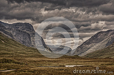 Areal View Of Green Grass Field Near Gray Mountains Under Gray Clouds Free Public Domain Cc0 Image