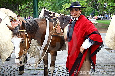 Argentina riders in red cape Editorial Image