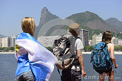 Argentinian sport fans in Rio de Janeiro with Christ the Redeemer in background.