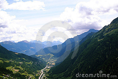 Arial view of road below mountains
