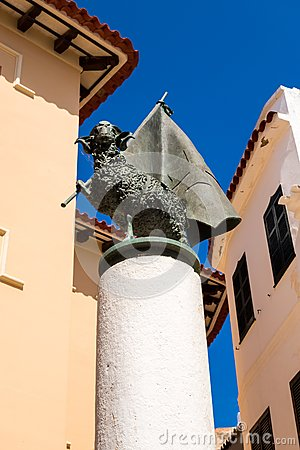 Free Aries With A Flag On A Column, Ciutatella De Menorca Center Stock Photography - 75593992
