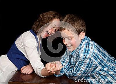 Arm-wrestling teenagers