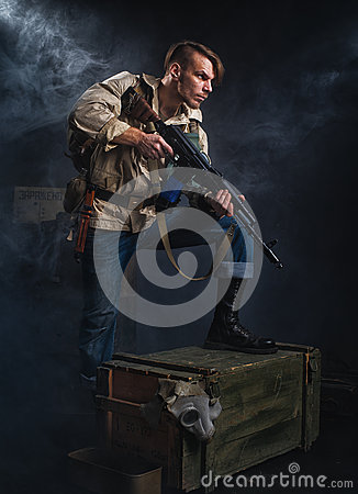Free Armed Man With A Gun. Stalker. Royalty Free Stock Images - 64866119