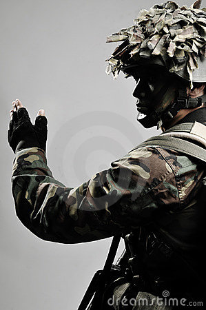 Armed soldier giving hand signal
