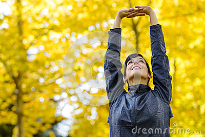 Arms up for stretching outside