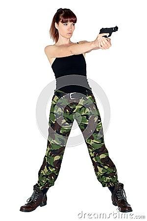 Army girl pointing a gun
