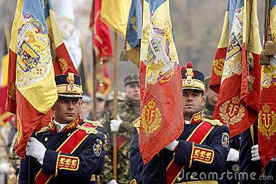 Army soldiers with flags at the parade Editorial Stock Image