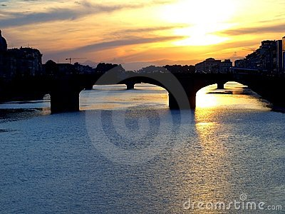 The Arno river in Florence at the sunset
