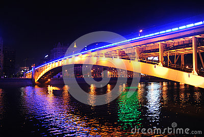 Arochny Bridge through the river Moscow at night