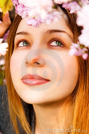 Aromatherapy - beautiful woman smelling flowers