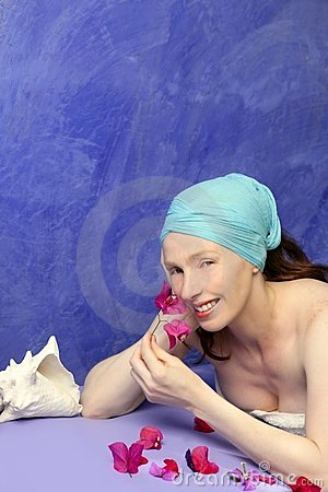 Aromatherapy on a blue board pink flowers