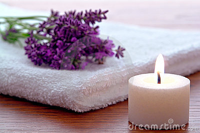 Aromatherapy Candle and Lavender Flowers in a spa