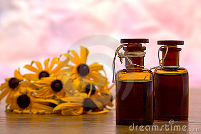 Aromatherapy Essential Oil Bottles and Flowers