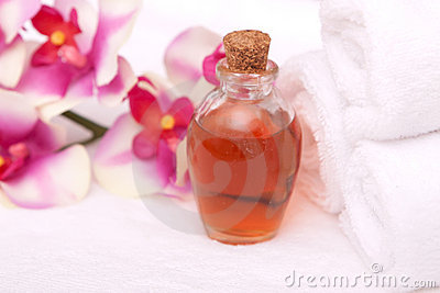 Aromatherapy oils, orchid and towels