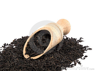 Aromatic black tea and wooden shovel