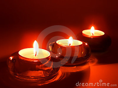 Aromatic candles in glass candlesticks