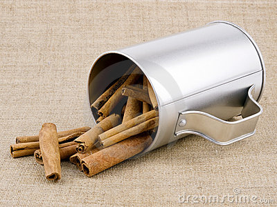 Aromatic cinnamon on linen background