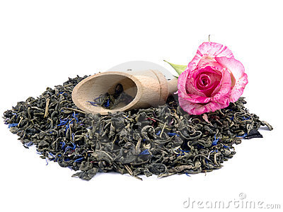 Aromatic green tea, wooden shovel and pink rose