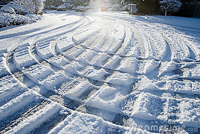 Array of tire tracks in the snow