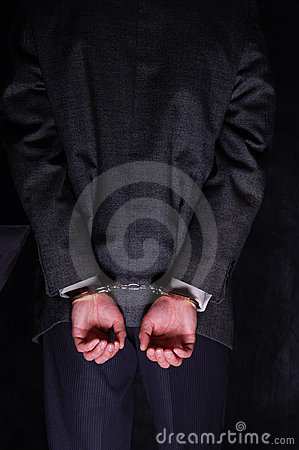 Arrested businessman handcuffed hands at the back