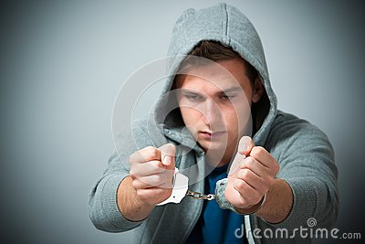 Arrested teenager with handcuffs