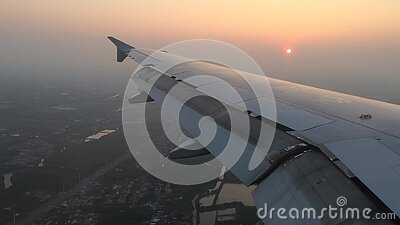 Arriving at the destination. Airplane arriving at destination and starting descend for landing at the Shanghai airport stock video footage