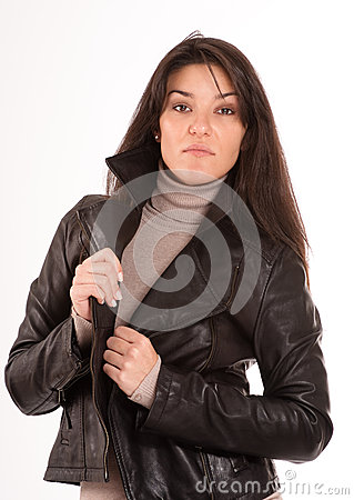 Arrogant brunette in a leather jacket