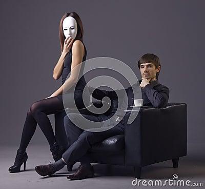 Arrogant man and masked woman