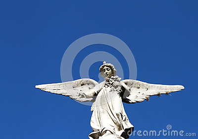 Guardian angel stone statue. Belief symbol.