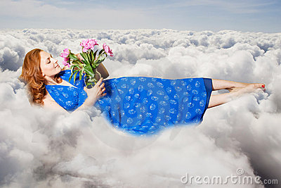 Art collage. beauty young woman on sky