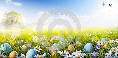 Art Colorful Easter eggs decorated with flowers in the grass Stock Photo