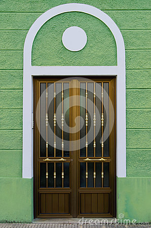 Free Art Deco Style House Door On A Green Wall Royalty Free Stock Image - 89475136