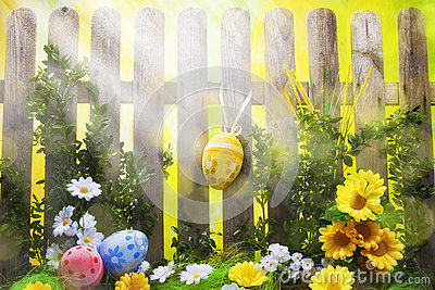 Art easter background with fence, eggs, spring flowers