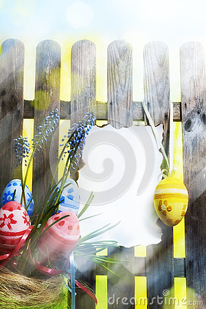 Art easter background with fence, eggs, spring flowers, blank ca