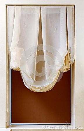 Art nouveau style curtain in window frame