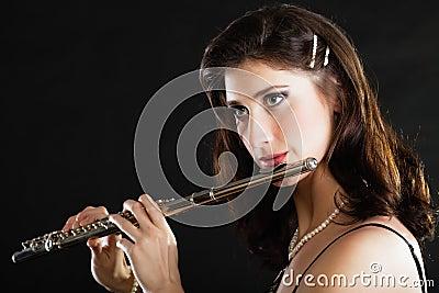 Art. Woman flutist flautist playing flute. Music.