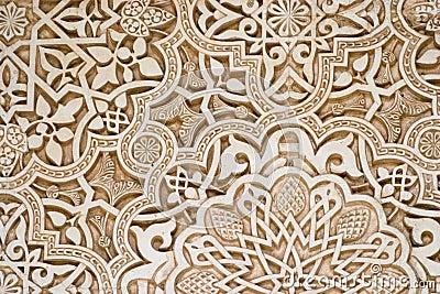Particolare dello scritto islamico su una parete a alhambra, granada