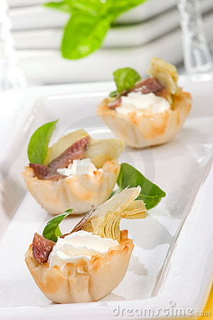 Artichoke anchovy and cream cheese canapes stock images for Cream cheese canape