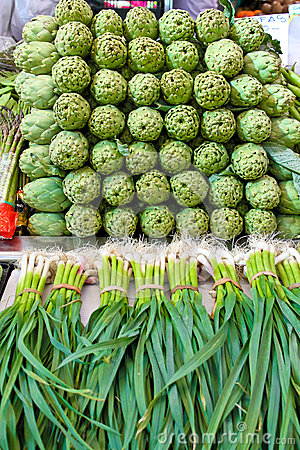 Artichoke and young garlic on a market
