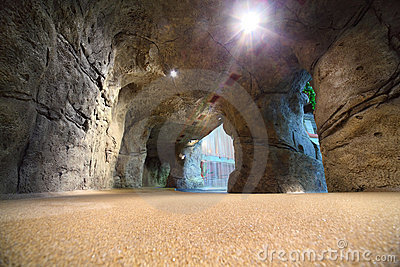 Artificial cave in waterpark with waterfall Stock Photo