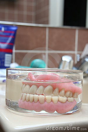 Artificial denture in a glass