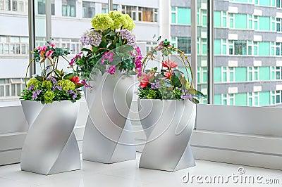 Artificial flowers in vases