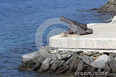 Artillery gun aiming at the sea